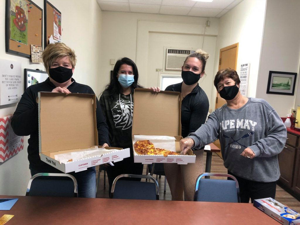 Teachers enjoy pizza purchased by Lions